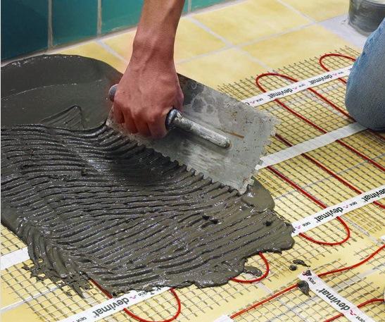 укладання електричної теплої підлоги фото